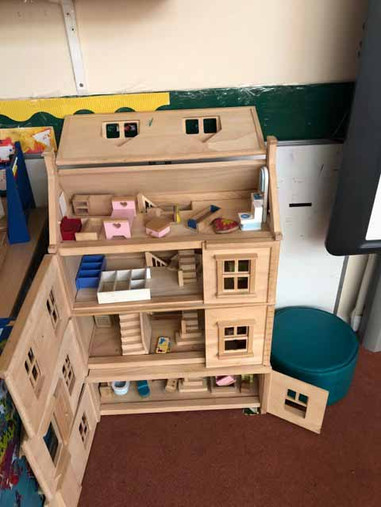 We are learning to decorate and furnish our houses using our giant dolls' house