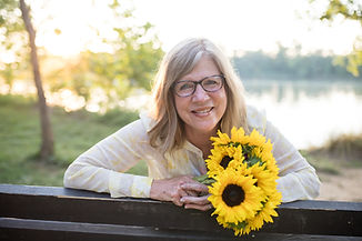 Sunflowers on bench.JPG