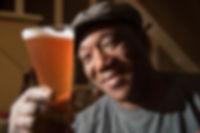 Leo Sawadogo Holding Beer