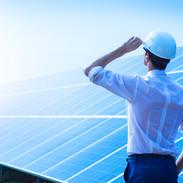 Solar power plant.jpg Man standing near solar panels.jpg Renewable energy.jpg