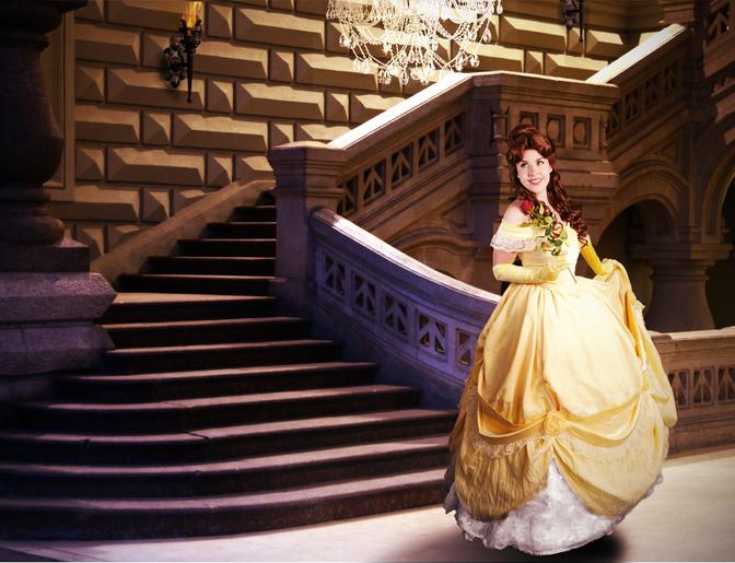 belle with rose at steps inside castle.p