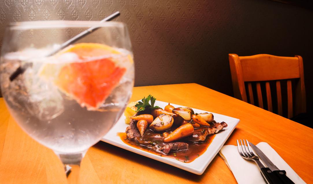food on table behind glass.jpg