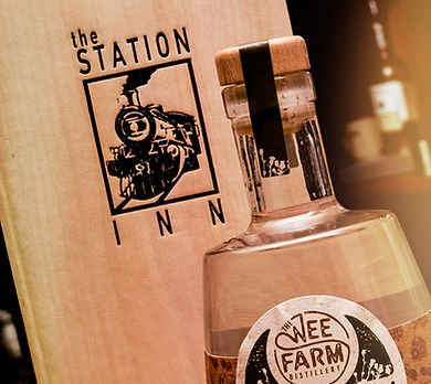 station iin photograph with gin  from the wee farm gin company