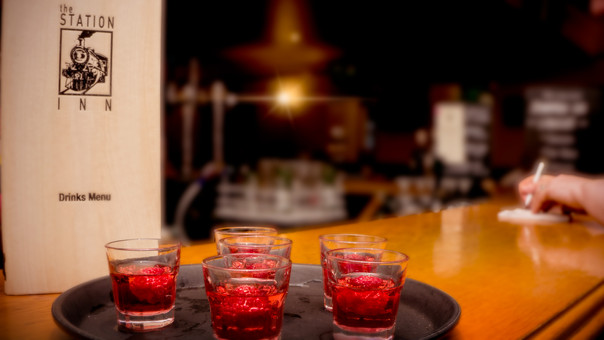 red glasses on top of bar.jpg