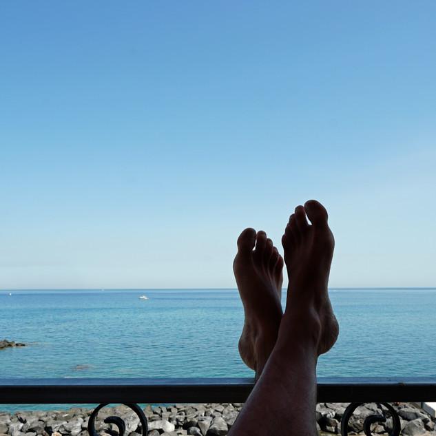 Relaxing on the balcony of the hotel room, Giardini Naxos, Italy