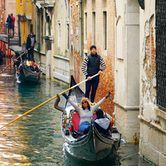 Happy tourist in Venice, Italy despite the flood in November 2019