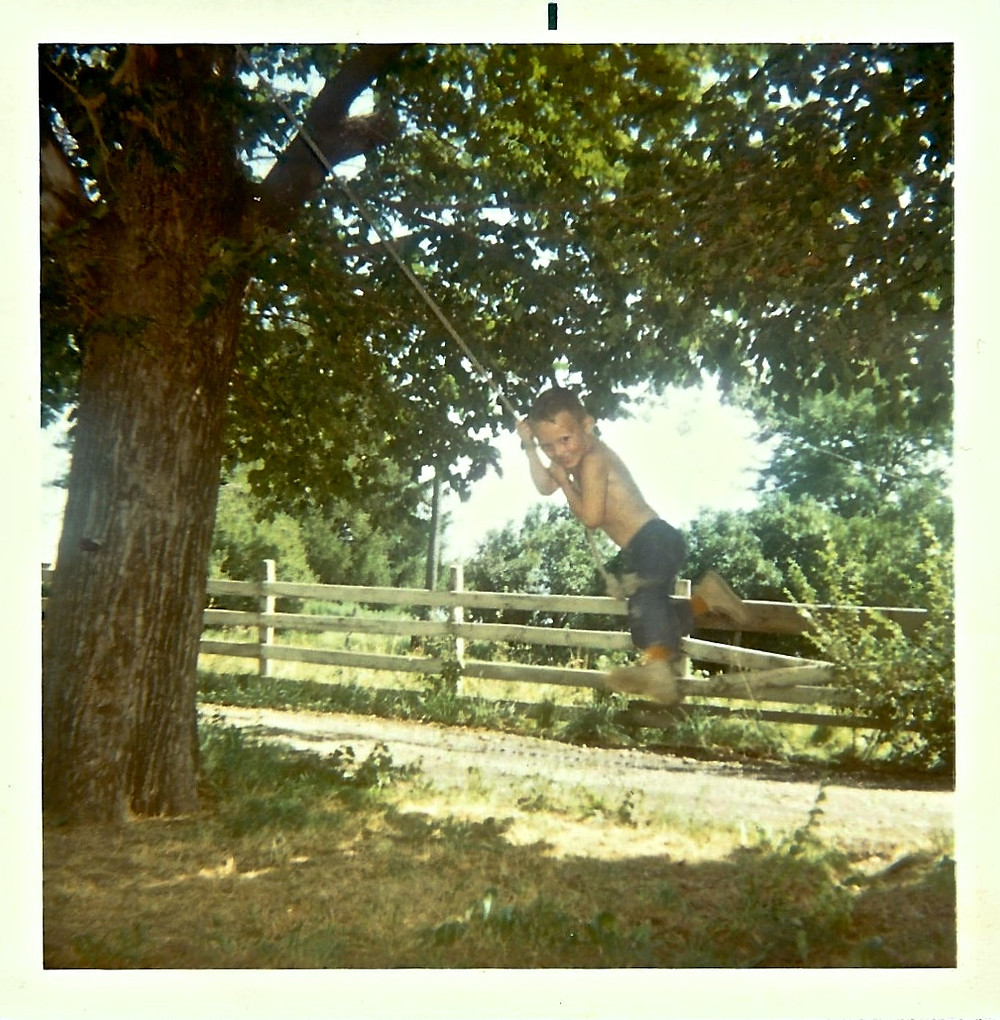 1970 the author swinging from a rope swing