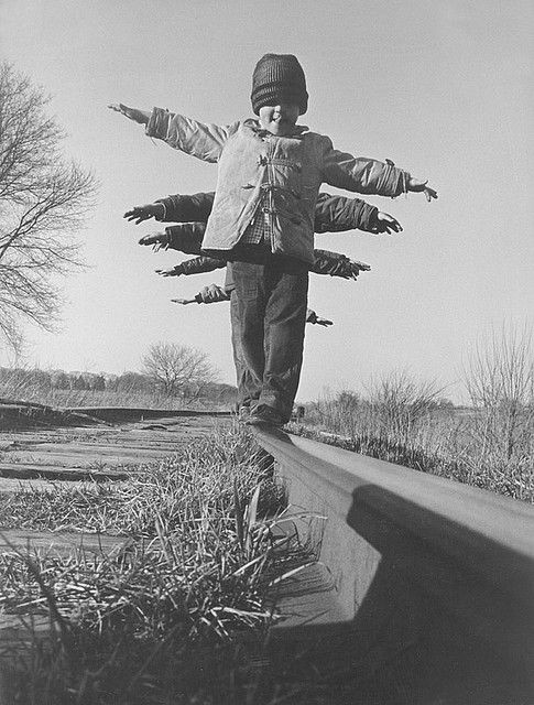 kids balancing on railroad rails