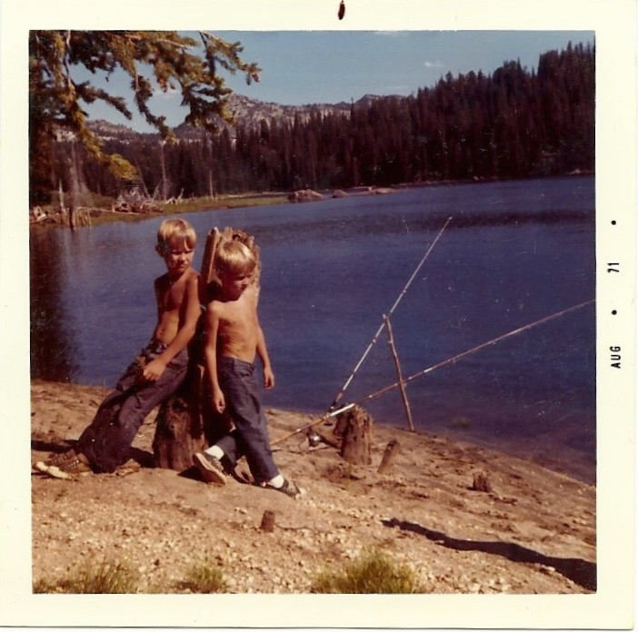 1971 two young boys fishing at a mountain lake