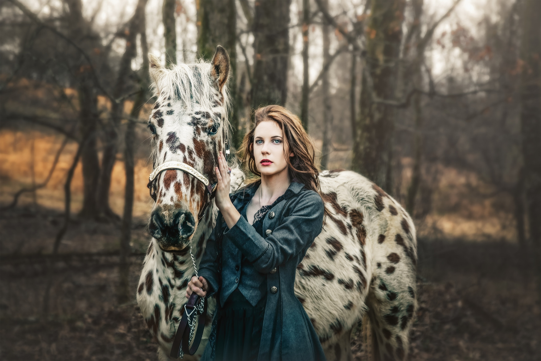 equine portrait of girl and her appaloosa horse . Equestrain portrait.
