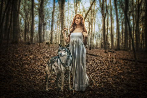 Woman and wolf in the forest.