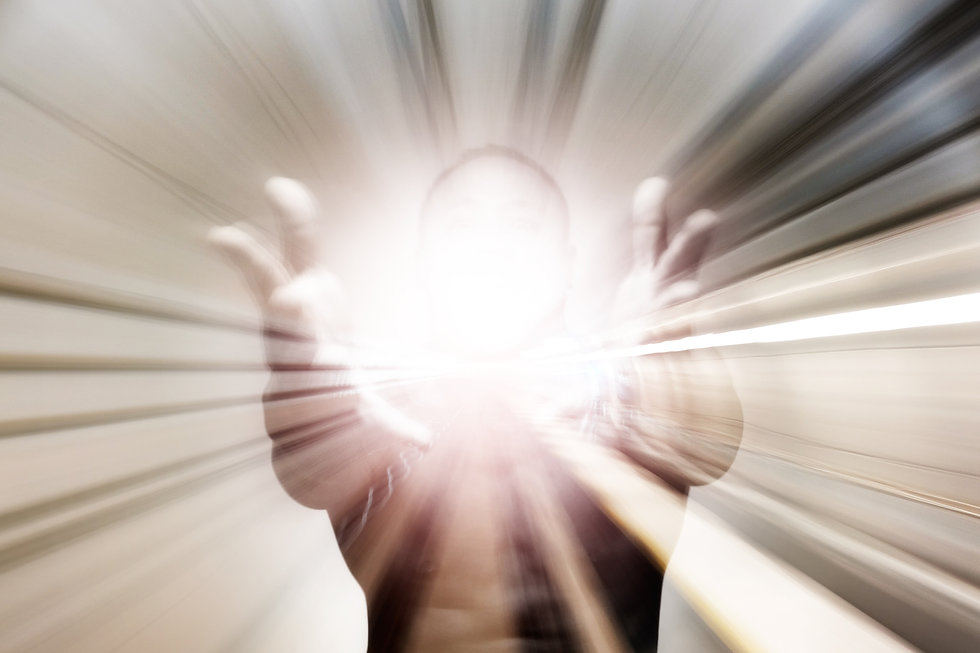 A man holding out his hand with an explosive shining light for the concept_ Presenting a s