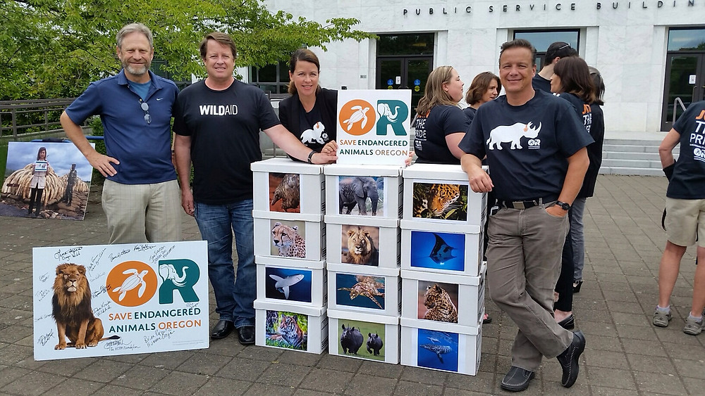 Humane Oregon board members Brian Posewitz, David Kracke and Scott Beckstead with Kristin Leppert, campaign manager for Save Endangered Animals Oregon.