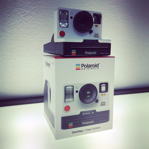 ed5b72f18214 Inspired by the original OneStep camera from 1977, the Polaroid OneStep 2  is an analog instant camera for the modern era. It's got a high quality  lens and a ...