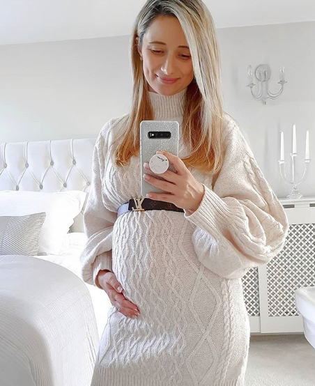 Stylish pregnant woman