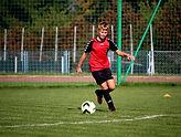 boy-playing-soccer-on-soccer-field.jpg