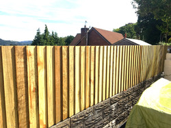Fence on top of wall By Helping AND