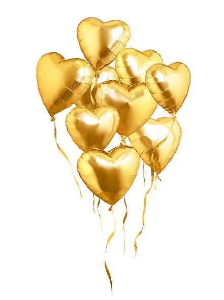 Flying golden heart shaped air balloons.