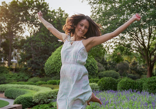 woman doing jumping pose for a photo
