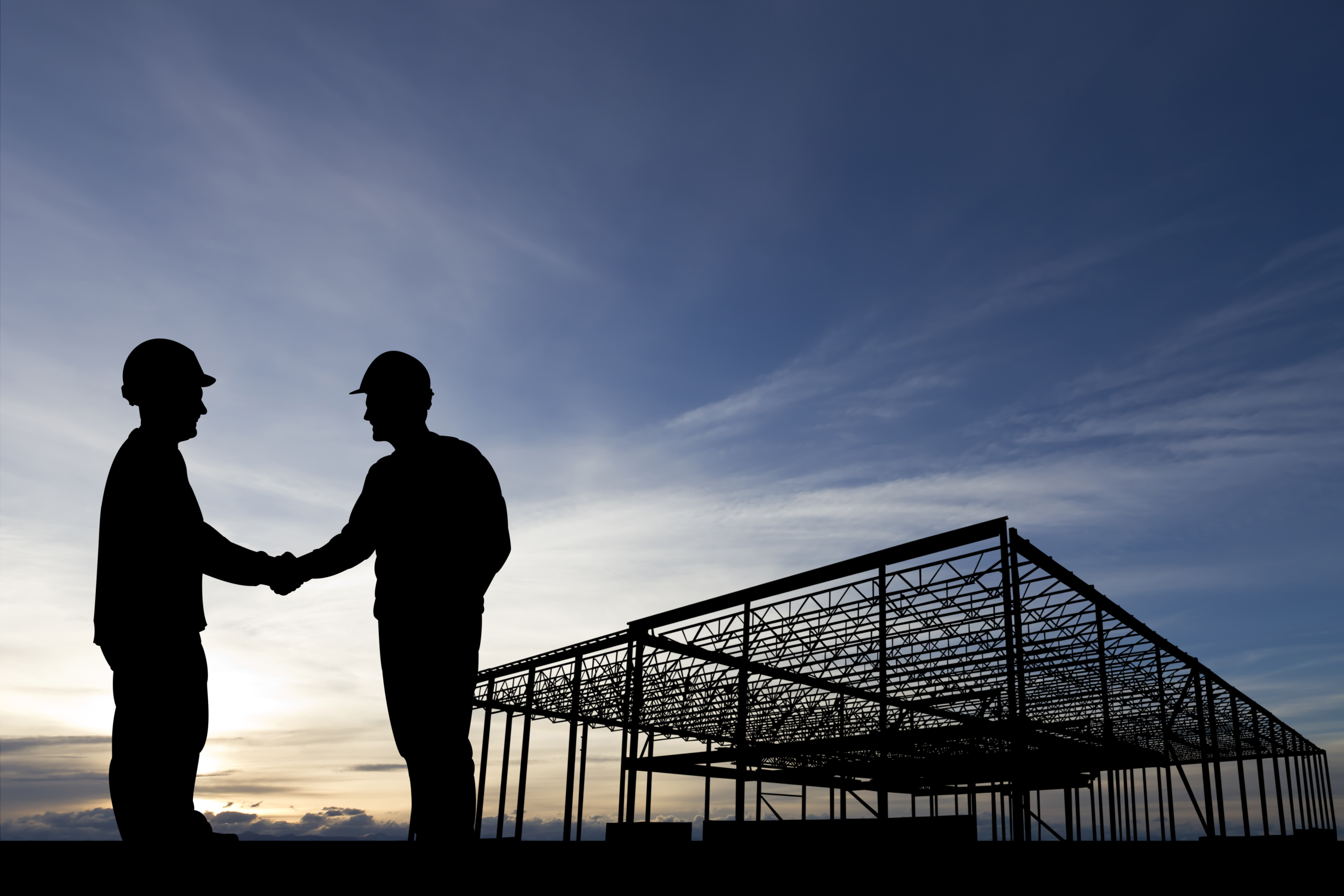 Construction-site-building-handshake