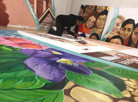 Working on mural in studio