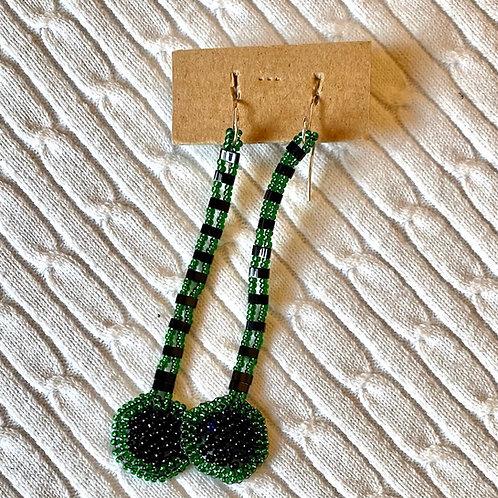 Green, black dangling earrings