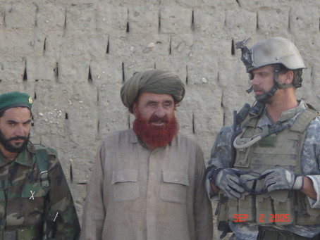 A Farmer, a Foreigner and a Field Full of Poppy in Southern Afghanistan