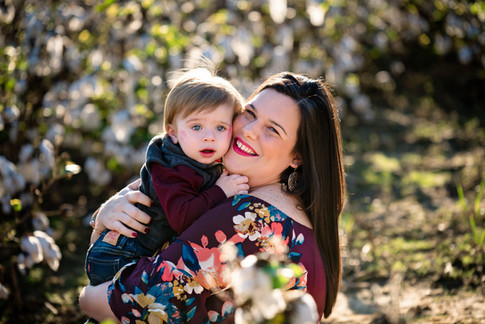 mom hugging son in cotton field