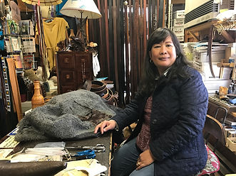 Teodora Ficca, leather worker, in her shop in Eastham Mass