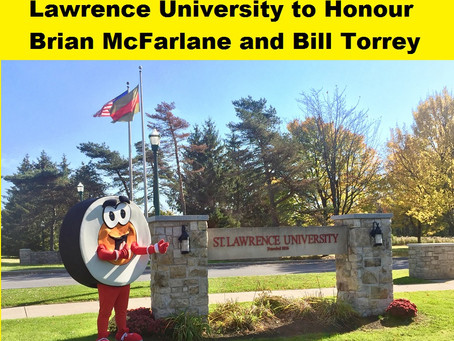 Peter Puck visits St. Lawrence University and honours Brian McFarlane and Bill Torrey