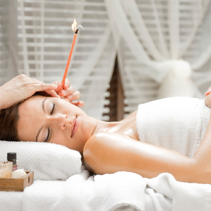 Ear candling being carried out on an att