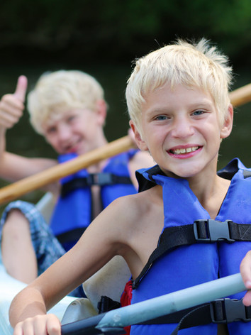 Happy boys kayaking