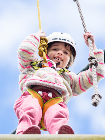 Girl on the high ropes course