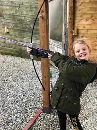 Girl enjoying Archery
