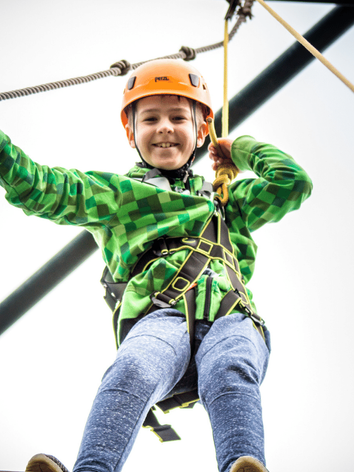 Boy enjoying the high ropes activity