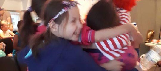 Mimi bringing joy to kids.jpg