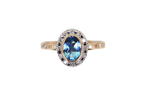 Classic diamond halo yellow gold ring with blue topaz