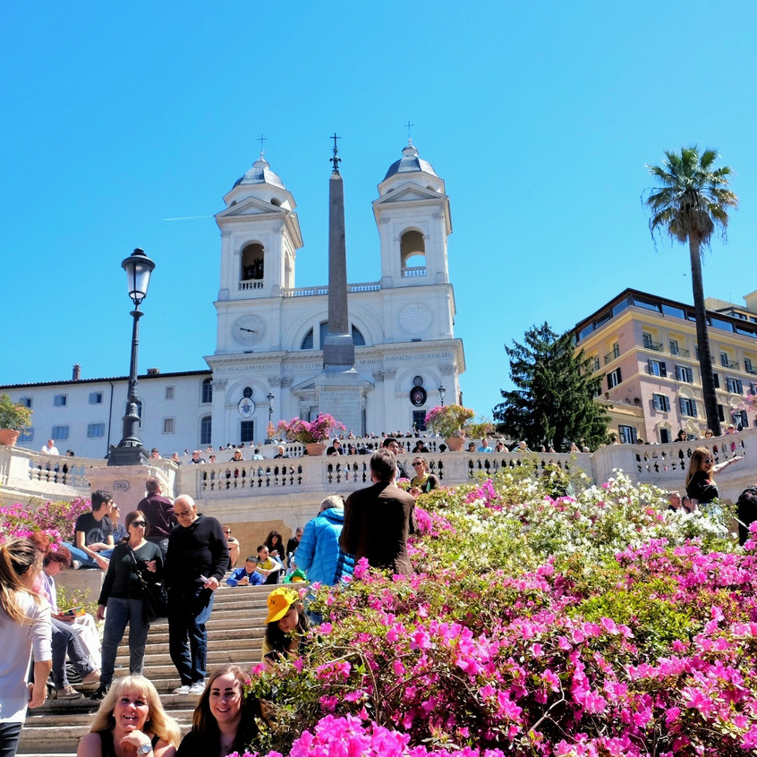 Sit and enjoy the colours and people fighting to take photos on the Spanish Steps