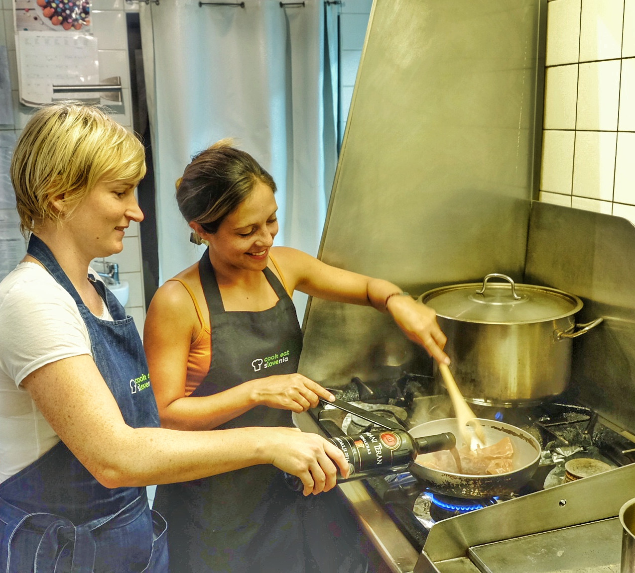 Spela and Stephanie Cooking the main Course at Cook Eat Slovenia, Ljubljana.