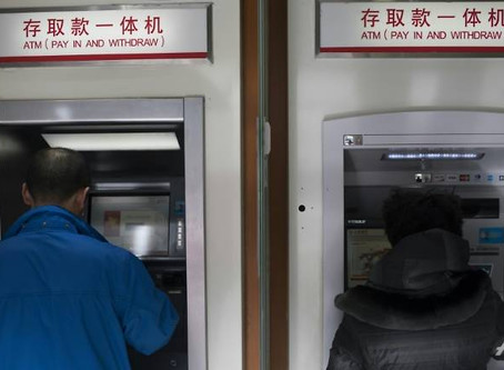 China cleans, locks away banknotes to stop virus spread