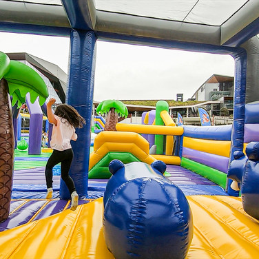 kids running through tuff nutterz obstacle course