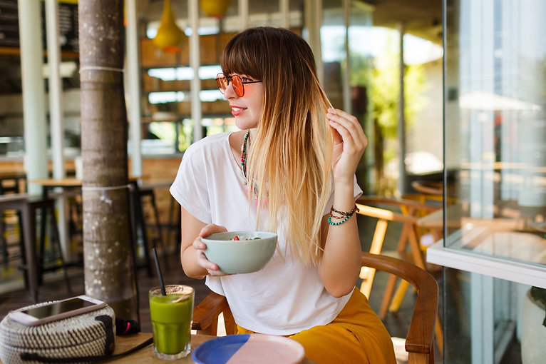 carefree-smiling-woman-eating-healthy-ve