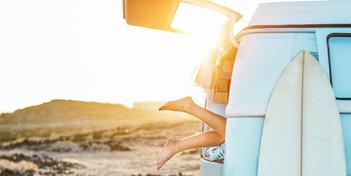 Legs view of happy surfer girl inside mi