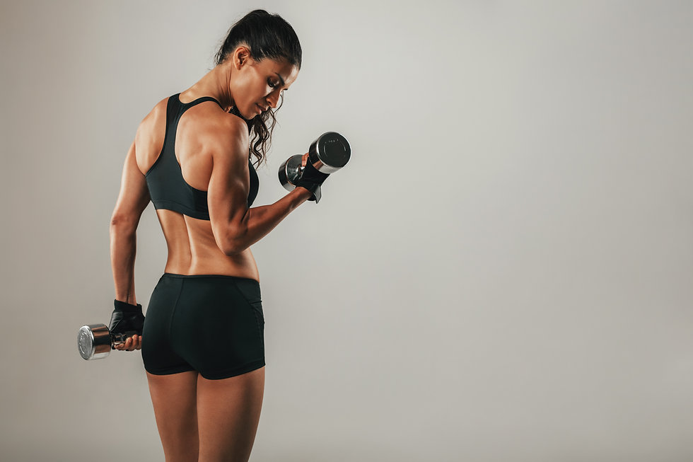 Fit strong young woman lifting weights w