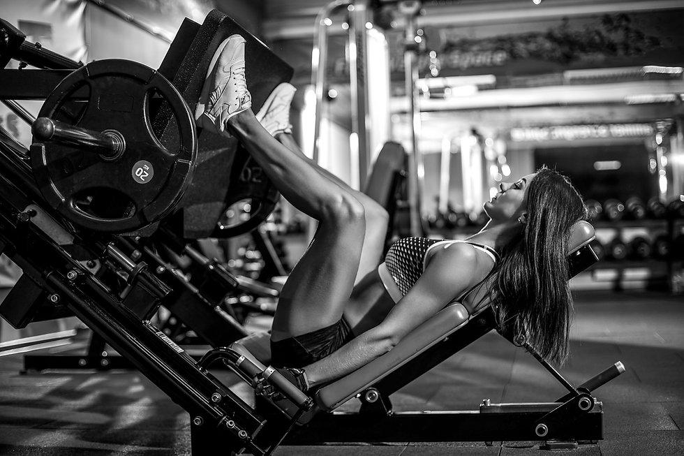 Woman doing fitness training on a leg ex