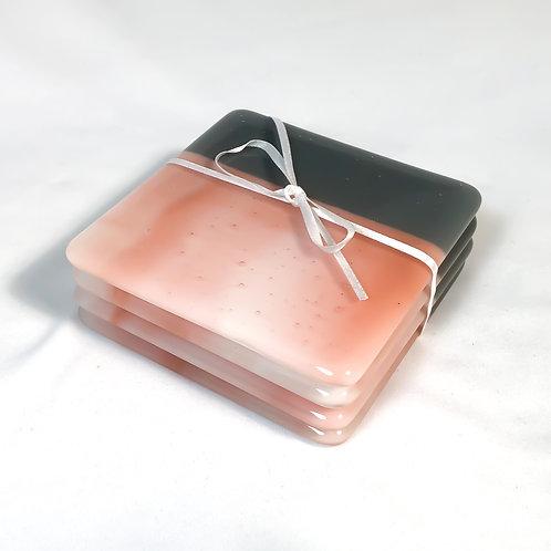 set of 4 coasters, salmon color streaky with dark gray border