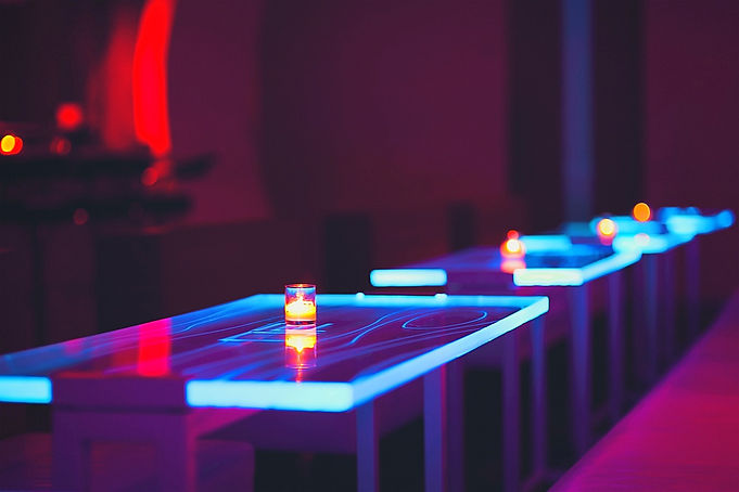 Mau 4th floor, blue LED lighted tables with candles in red ambient lights
