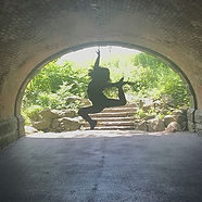 Me jumping at the end of a tunnel in Central Park
