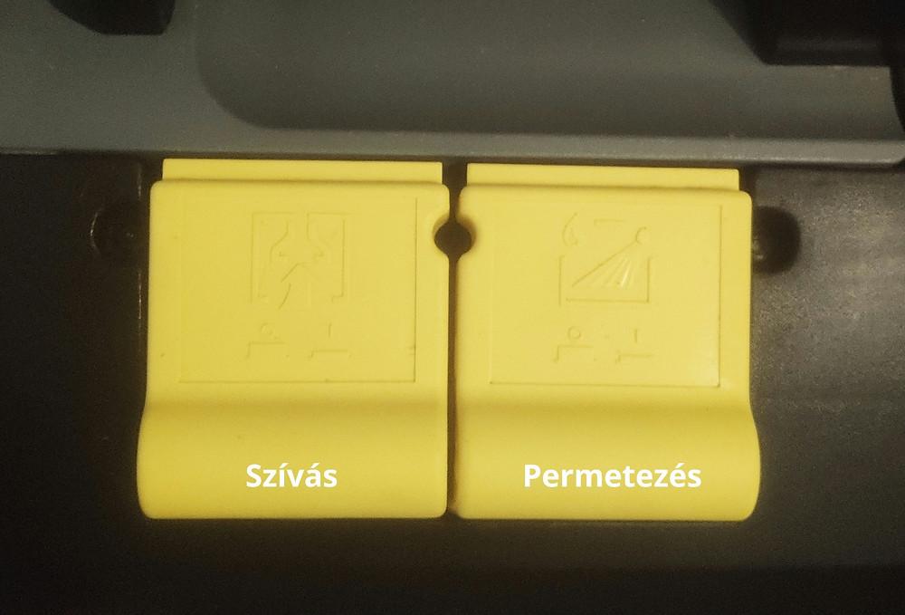 Ezen a képen a Karcher Puzzi 10/1 szőnyeg- és kárpittisztító gépnek látható az indító gomjai