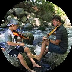 teaching fiddle outside in creek